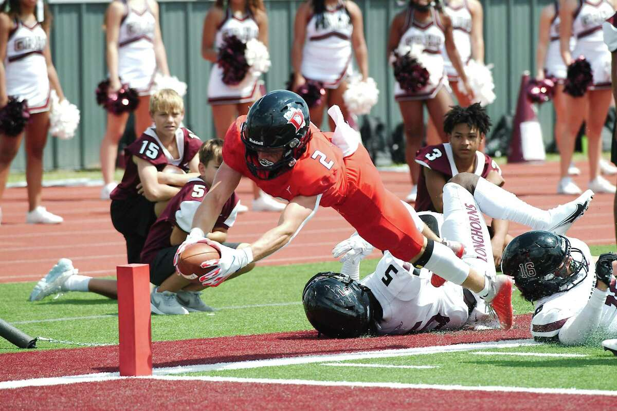 Dawson's Ryan Guillo (2) dives into the end zone for a touchdown against George Ranch Saturday at Pearland Stadium.