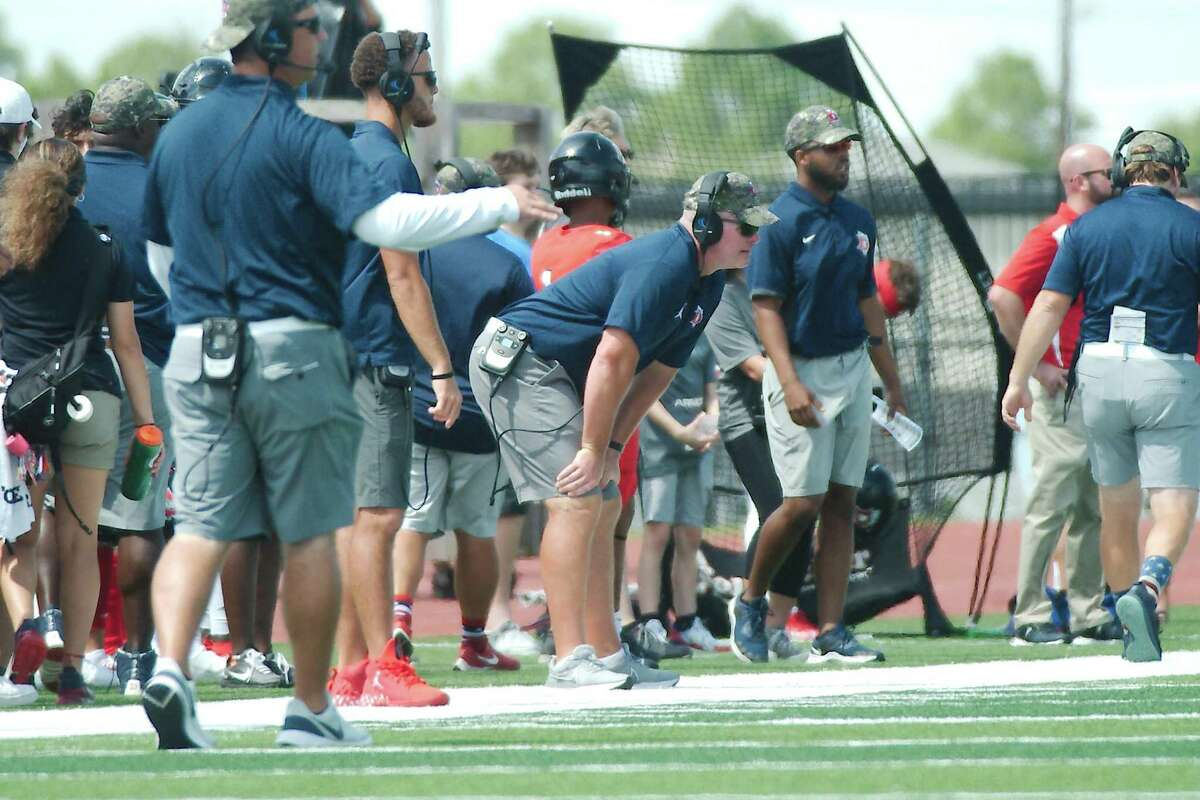 Dawson head football coach Mike Allison (hands on knees, center) know his team will have to be at its best to defeat Shadow Creek this Friday.