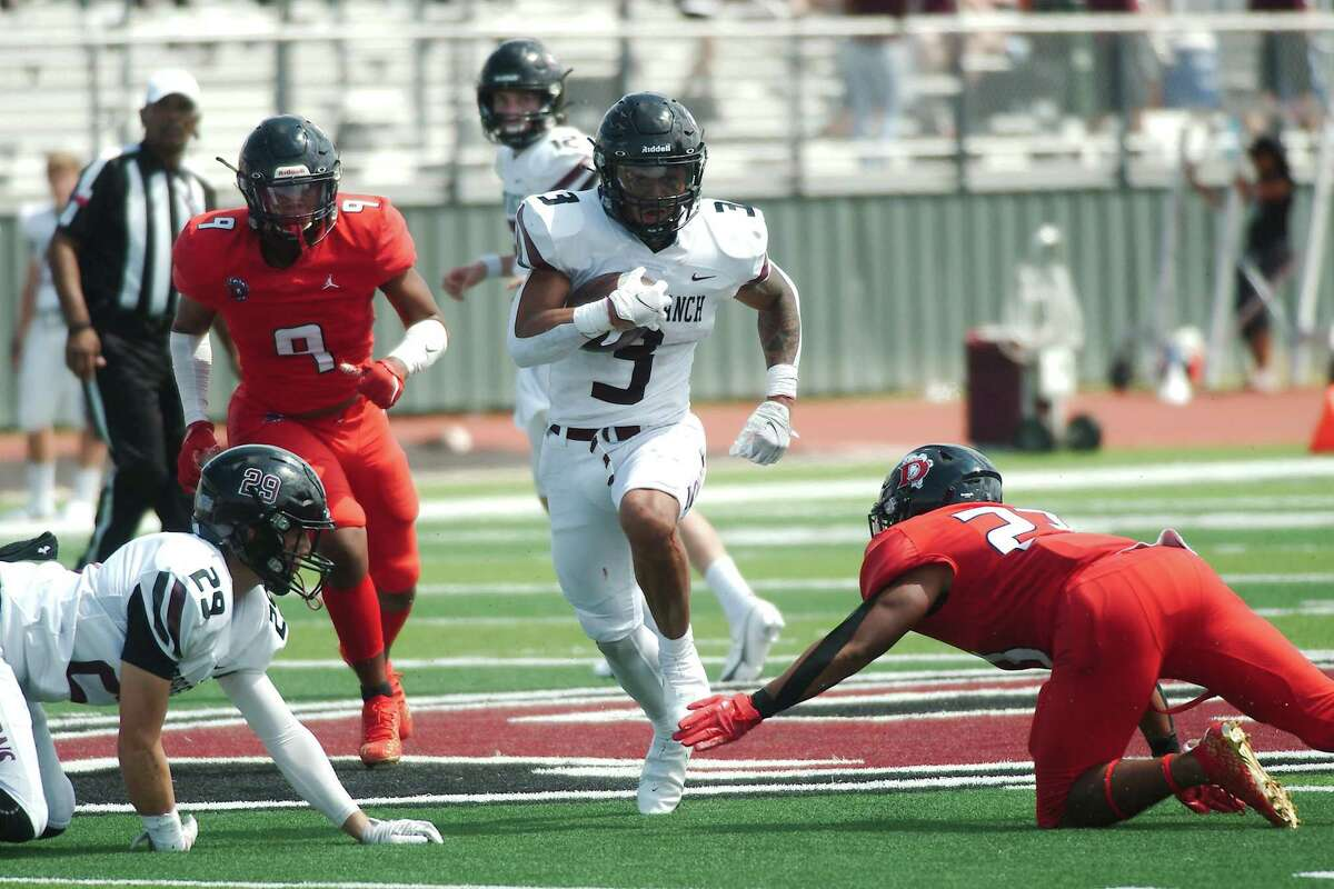 George Ranch's Hymond Drinkard (3) finds a hole in in the Dawson defense Saturday at Pearland Stadium.