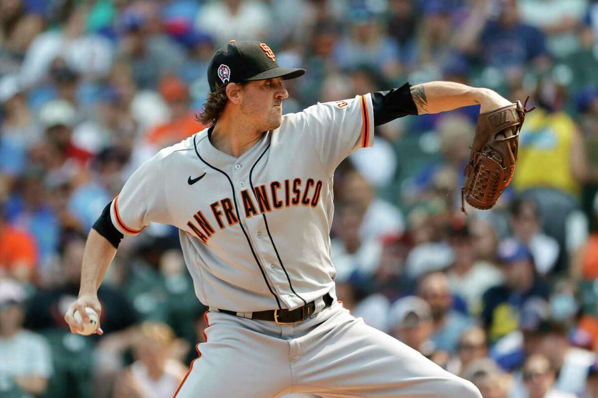 San Francisco Giants starting pitcher Kevin Gausman (34) delivers against the Chicago Cubs during the first inning of a baseball game, Saturday, Sept. 11, 2021, in Chicago. (AP Photo/Kamil Krzaczynski)