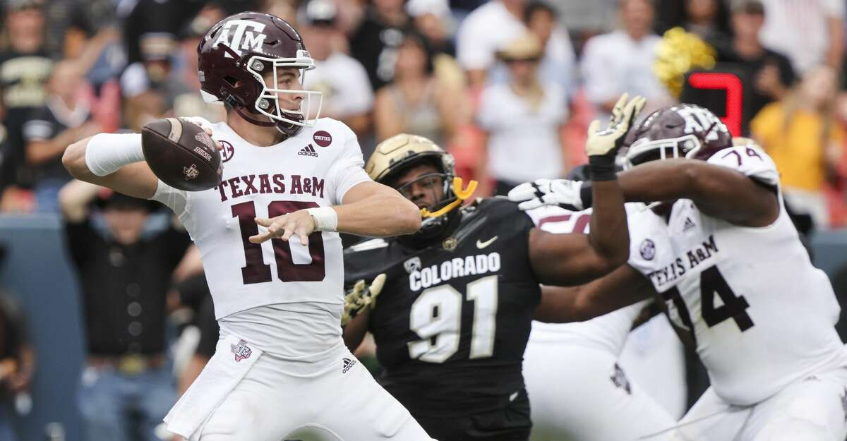 Zach Calzada #10 of the Texas A&M Aggies attempts a pass against the Colorado Buffaloes during the second quarter at Empower Field At Mile High on September 11, 2021 in Denver, Colorado. (Photo by Michael Ciaglo/Getty Images)