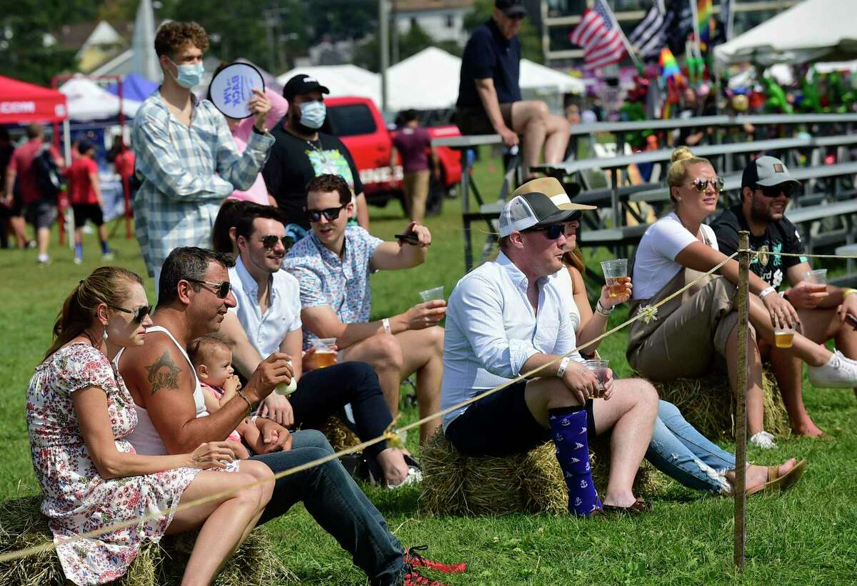 People cheer for kights battling in the Knights Corner during the 43rd Annual Norwalk Oyster Festival Saturday, September 11, 2021, at Veterans Memorial Park in Norwalk, Conn.