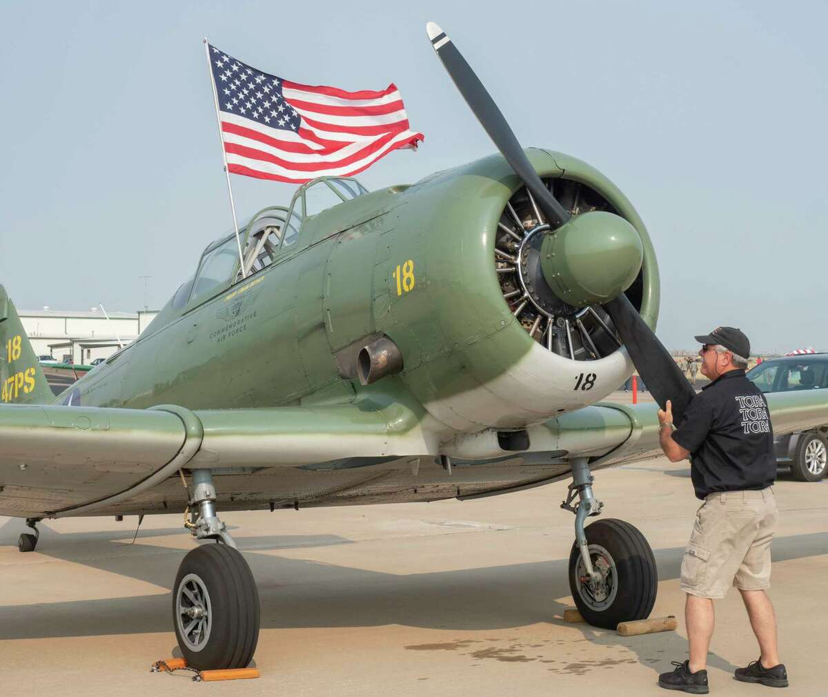 Craig Hutain, Tora 18 Hawk, from Montgomery, TX, rotates the propeller of his T-6 to clear oil in the bottom cylinders as he readies his plane 09/11/2021 before the start of the flying at Midland International Air and Space Port. Tim Fischer/Reporter-Telegram