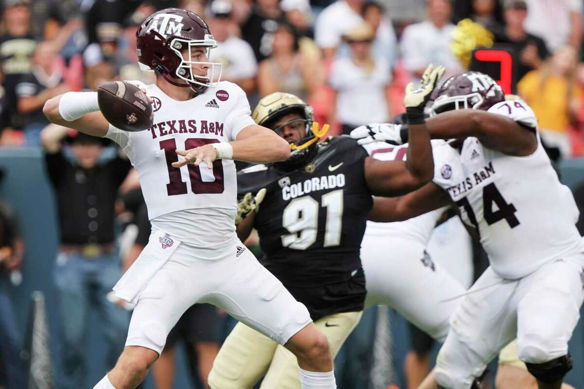DENVER, CO - SEPTEMBER 11: Zach Calzada #10 of the Texas A&M Aggies attempts a pass against the Colorado Buffaloes during the second quarter at Empower Field At Mile High on September 11, 2021 in Denver, Colorado. (Photo by Michael Ciaglo/Getty Images)