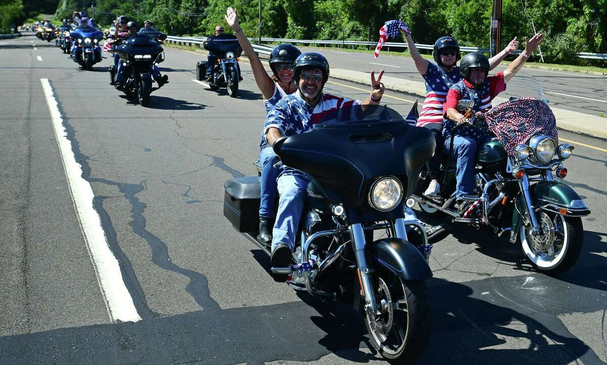 Nearly 5,000 riders head out from Sherwood Island State Park for the V Saturday, September 11, 2021, in Westport, Conn. The CT United Ride is a non-stop motorcycle 9/11 tribute to Seaside Park in Bridgeport which passes through 9 towns along the route.