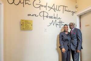 Pastors Lanre and Abiola Peters stand inside the Redeemed Christian Church of God at 475 State St. in Albany, NY. The congregation, which is active in the community and had been worshiping on Lexington Avenue, held a grand opening for its recently purchased sanctuary on Saturday, Sept. 11, 2021. (Jim Franco/Special to the Times Union)