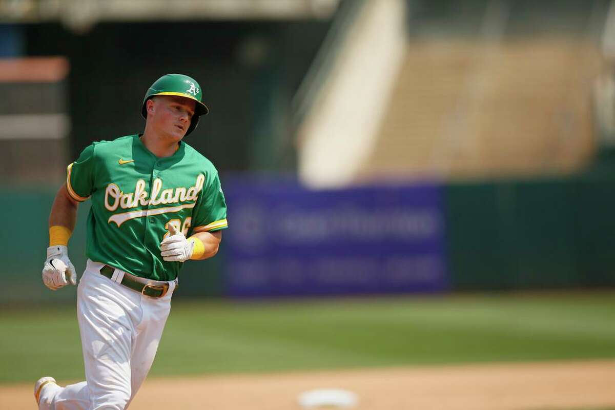 Oakland Athletics Matt Chapman (26) homers in the fourth inning during an MLB game against the New York Yankees at RingCentral Coliseum on Saturday, Aug. 28, 2021, in Oakland, Calif.