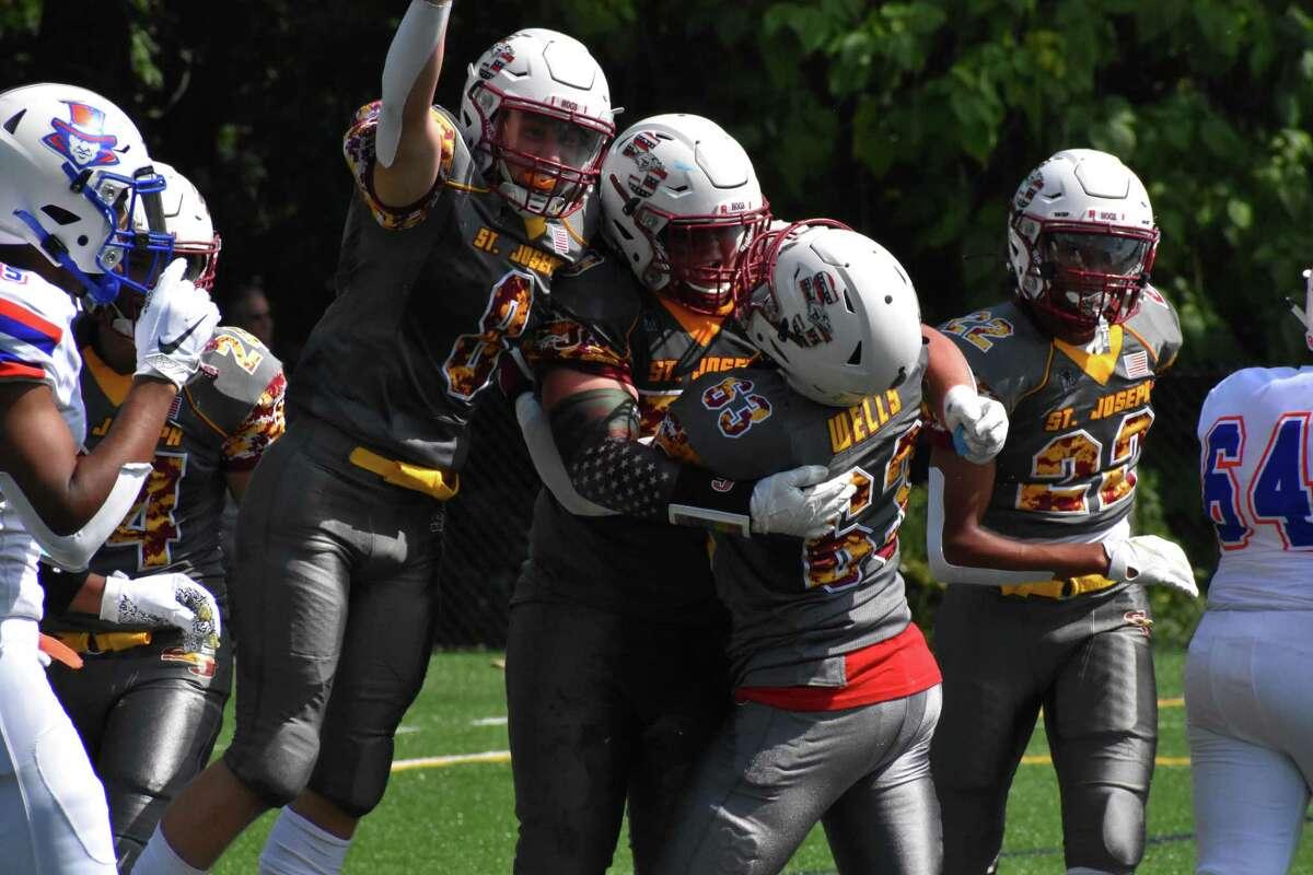 St. Joseph's Joey Sansone (50) celebrates after scoring a touchdown a football game between St. Joseph and Danbury at St. Joseph high school, Trumbull on Saturday, Sept. 11, 2021.