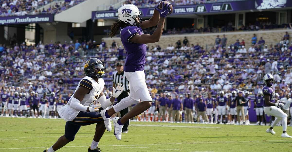 TCU wide receiver Quentin Johnston (1) catches a pass for a touchdown in front of California cornerback Chigozie Anusiem (7) in the second half of an NCAA college football game in Fort Worth, Texas, Saturday, Sept. 11, 2021. (AP Photo/Tony Gutierrez)