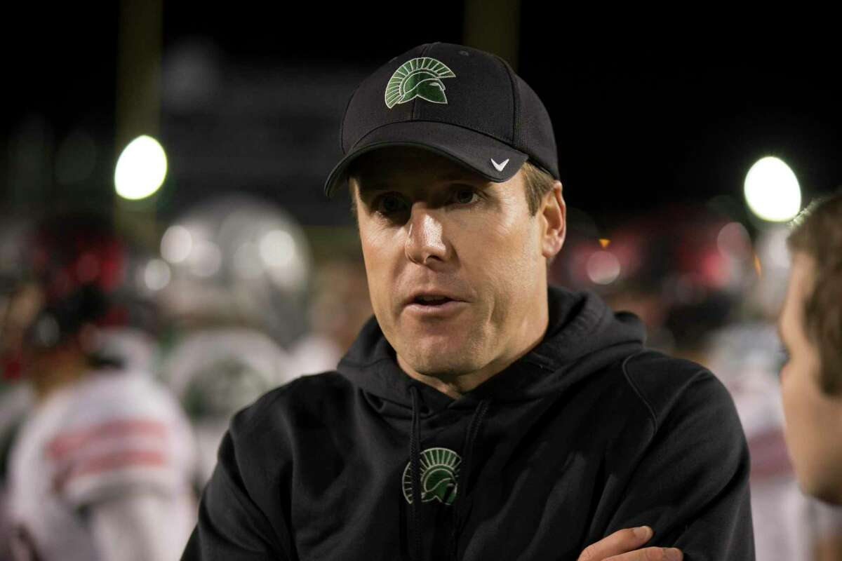 De La Salle head coach Justin Alumbaugh talks to reporters following his team's victory in an NCS high school football playoff game against Clayton Valley, on Friday, Nov. 18, 2016 in Concord, Calif. De La Salle won, 28-0.