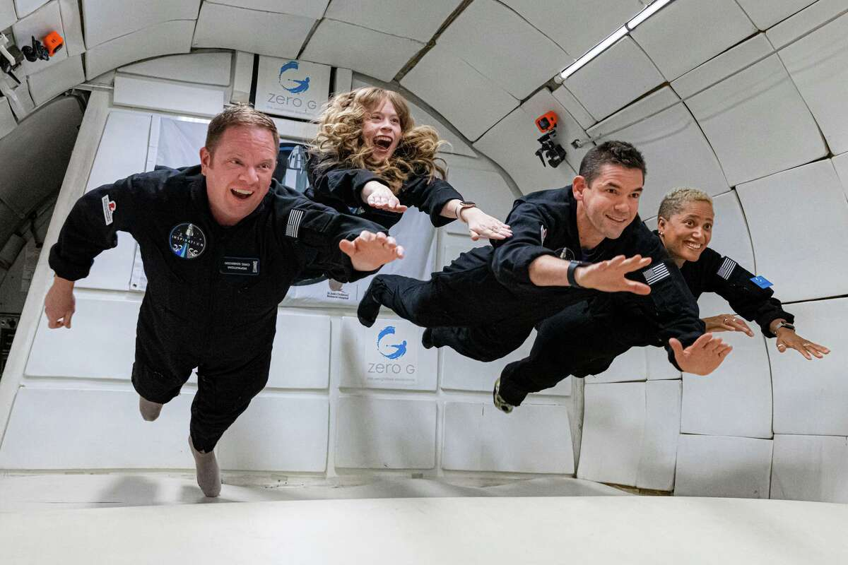 The Inspiration4 crew experiences weightlessness during a Zero-G parabolic flight on July 11, 2021. Pictured, from left, are Chris Sembroski, Hayley Arceneaux, Jared Isaacman and Sian Proctor.