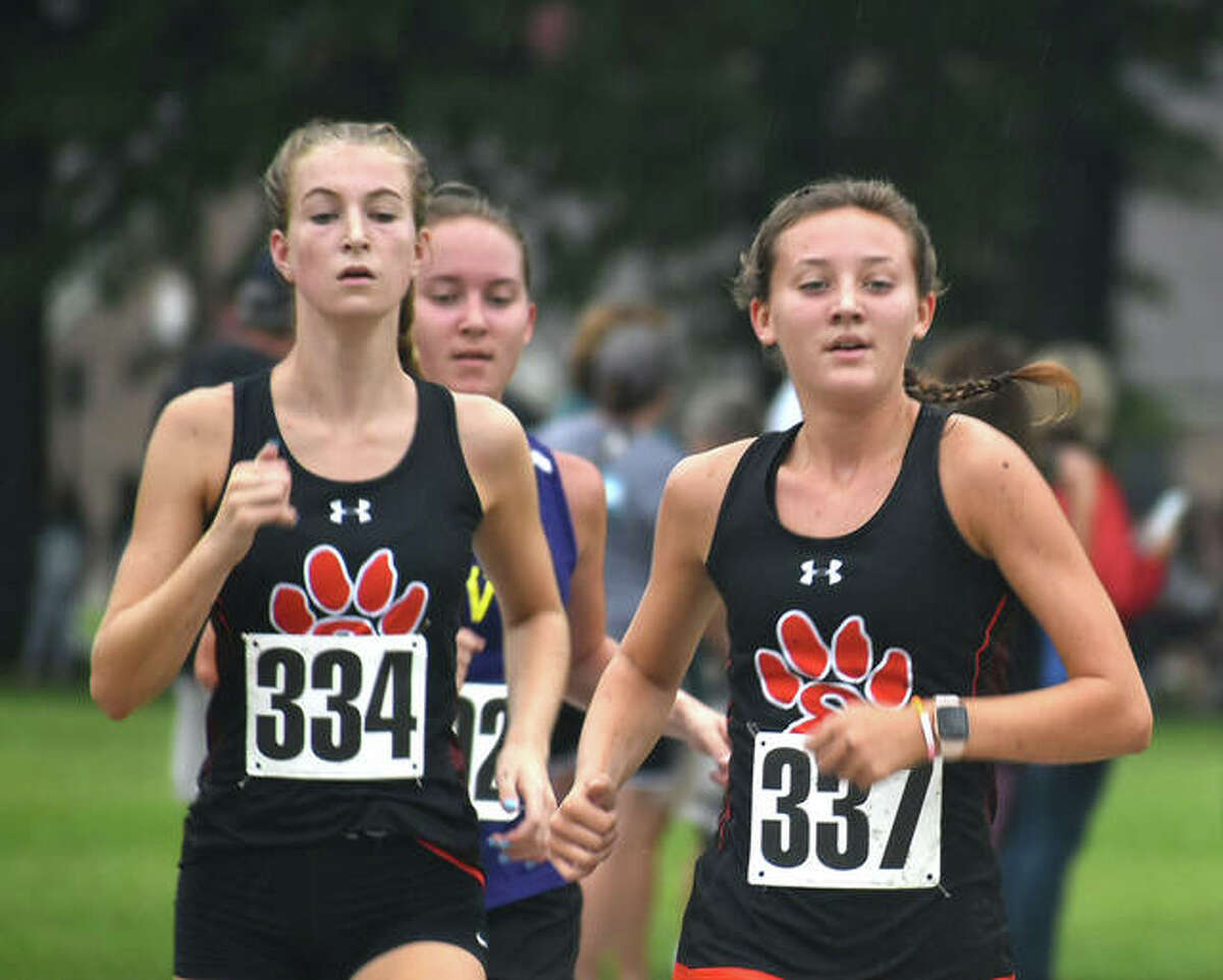 Edwardsville's Maya Lueking, left, and Emily Nuttall compete in the Granite City Invitational.