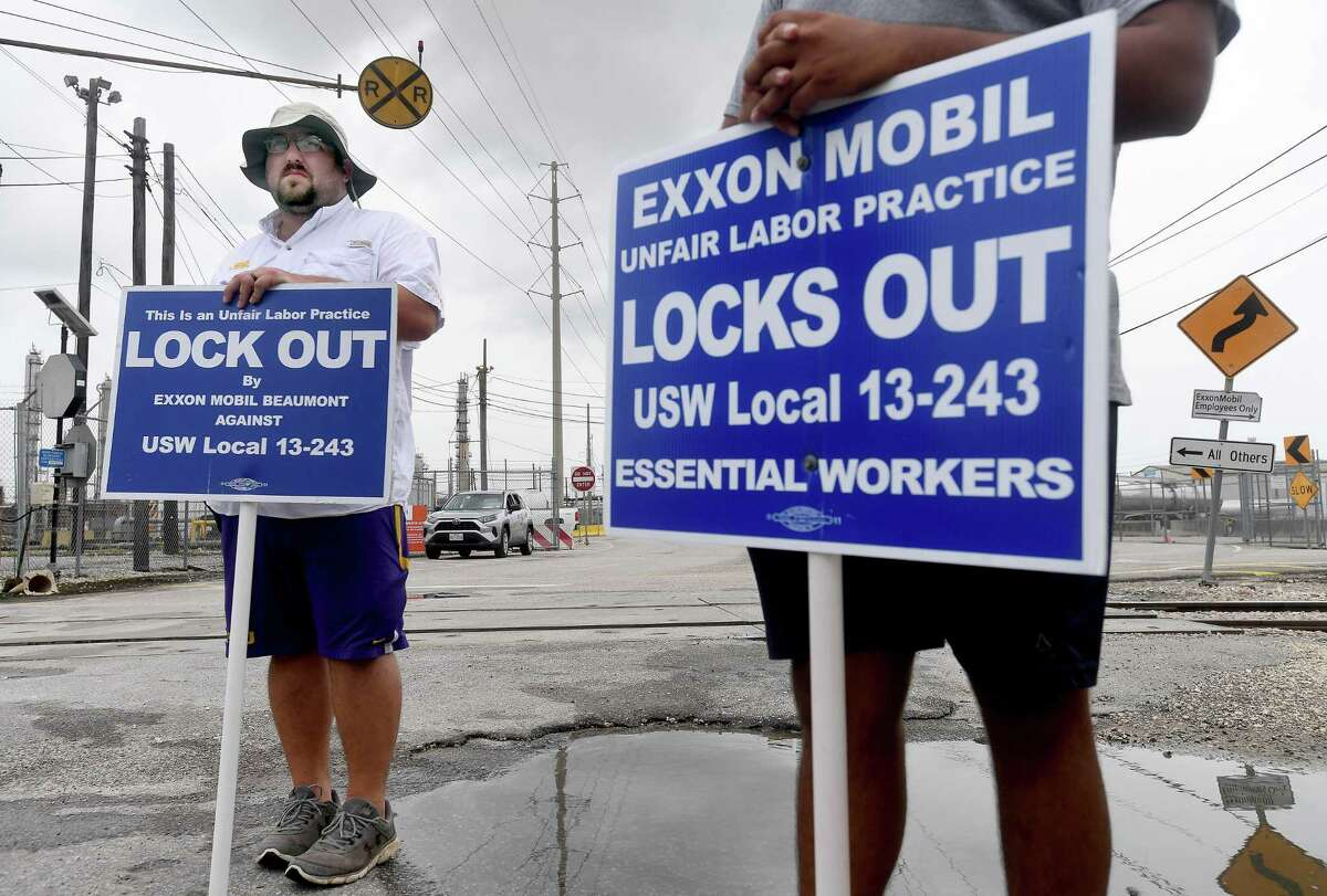 Locked out United Steel Workers Union members, including (from left) Zachary Simon and Carlos Soto, take their shifts picketing outside Beaumont's ExxonMobil plant on Labor Day. Photo made Monday, September 6, 2021 Kim Brent/The Enterprise