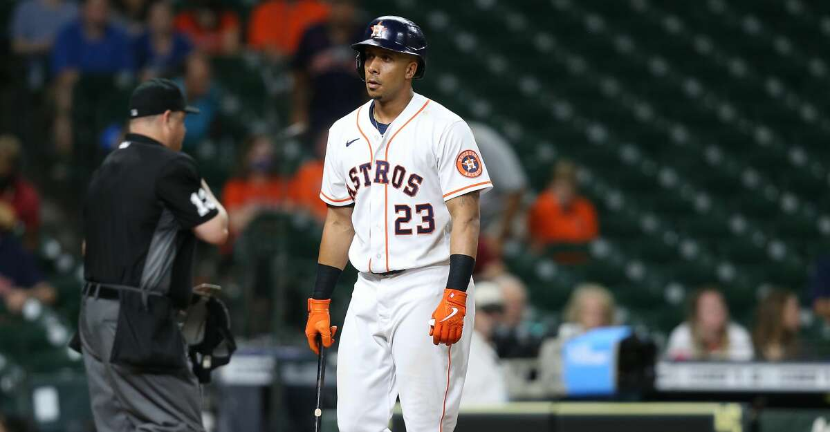 Houston Astros left fielder Michael Brantley (23) reacts to striking out ending the ninth inning against the Kansas City Royals at Minute Maid Park in Houston on Monday, Aug. 23, 2021. Kansas City Royals won the game 7-1.