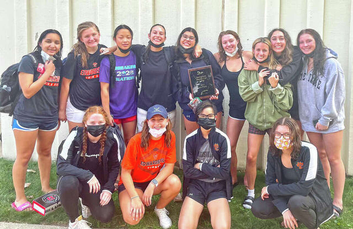 Members of the Edwardsville girls swim team pose with the first-place plaque from the Capital City Invite on Saturday at Eisenhower Pool in Springfield.