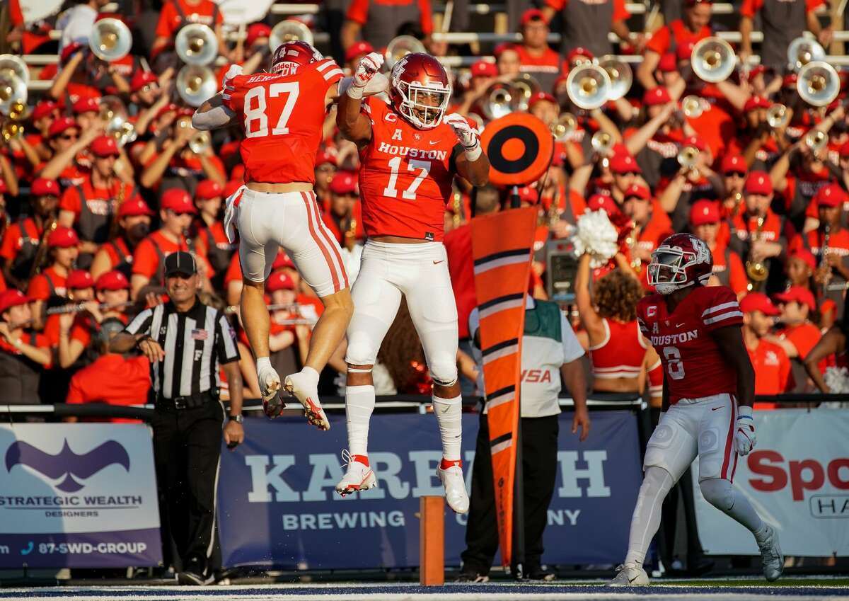Houston Cougars wide receiver Jake Herslow (87) celebrates with Houston Cougars tight end Seth Green (17) after scoring a 11-yard receiving touchdown against the Rice Owls during the first quarter of an NCAA game at Rice Stadium on Saturday, Sept. 11, 2021, in Houston.