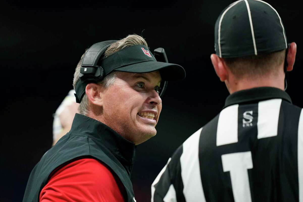 Lamar head coach Blane Morgan, left, argues a call during the first half of the team's NCAA college football game against UTSA, Saturday, Sept. 11, 2021, in San Antonio. (AP Photo/Eric Gay)