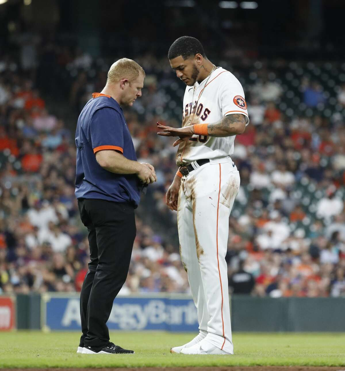 Houston Astros Jose Siri (26) gets help with a bloody finder after stealing second base from Los Angeles Angels shortstop Luis Rengifo (2) during the fourth inning of a MLB baseball game at Minute Maid Park, Saturday, September 11, 2021, in Houston.