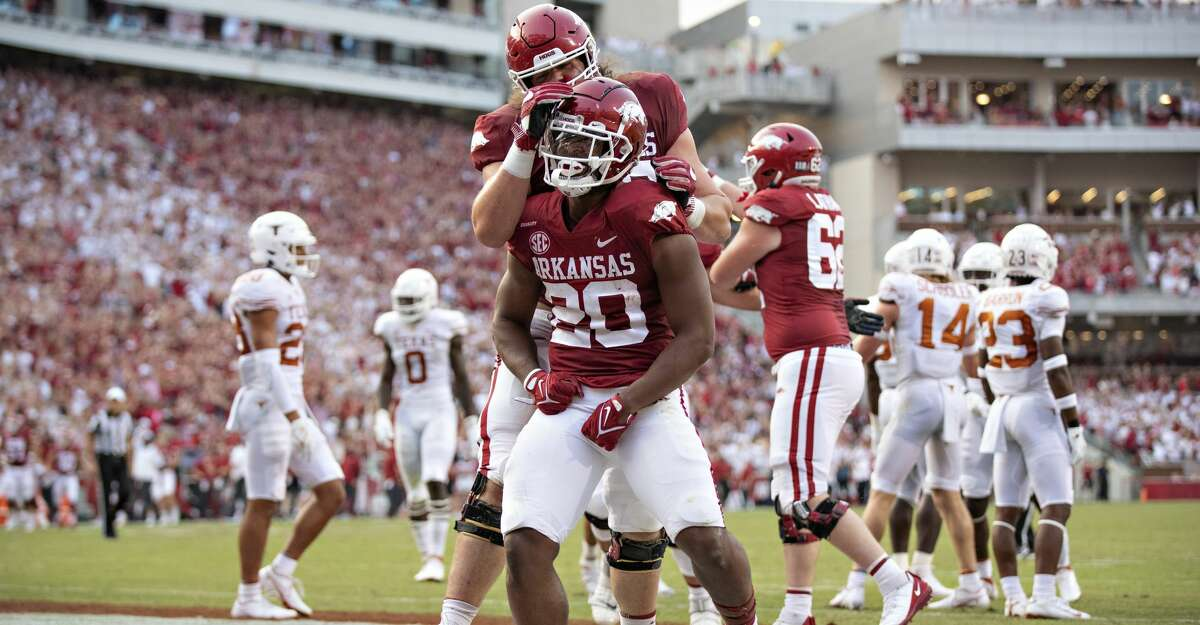 Dominique Johnson #20 of the Arkansas Razorbacks celebrates after scoring a touchdown in the first half of a game against the Texas Longhorns at Donald W. Reynolds Razorback Stadium on September 11, 2021 in Fayetteville, Arkansas. (Photo by Wesley Hitt/Getty Images)