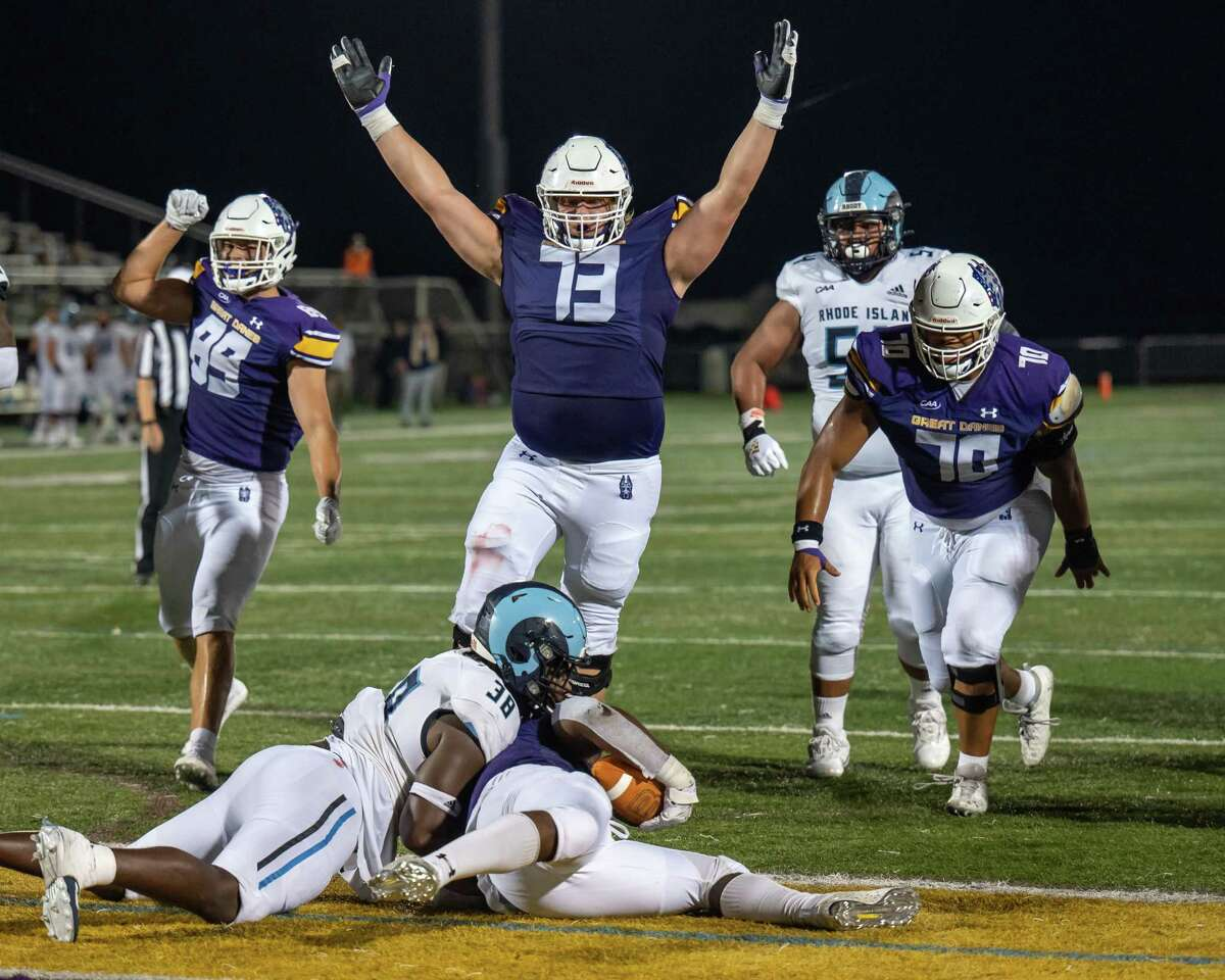 UAlbany lineman Scott Houseman celebrates a touchdown run by running back Karl Mofor during the Great Danes home opener against Rhode Island on Saturday, Sept. 11, 2021. (Jim Franco/Special to the Times Union)