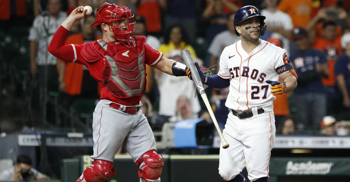 Houston Astros Jose Altuve (27) strikes out against Los Angeles Angels relief pitcher Raisel Iglesias (32) during the ninth inning of a MLB baseball game at Minute Maid Park, Saturday, September 11, 2021, in Houston.