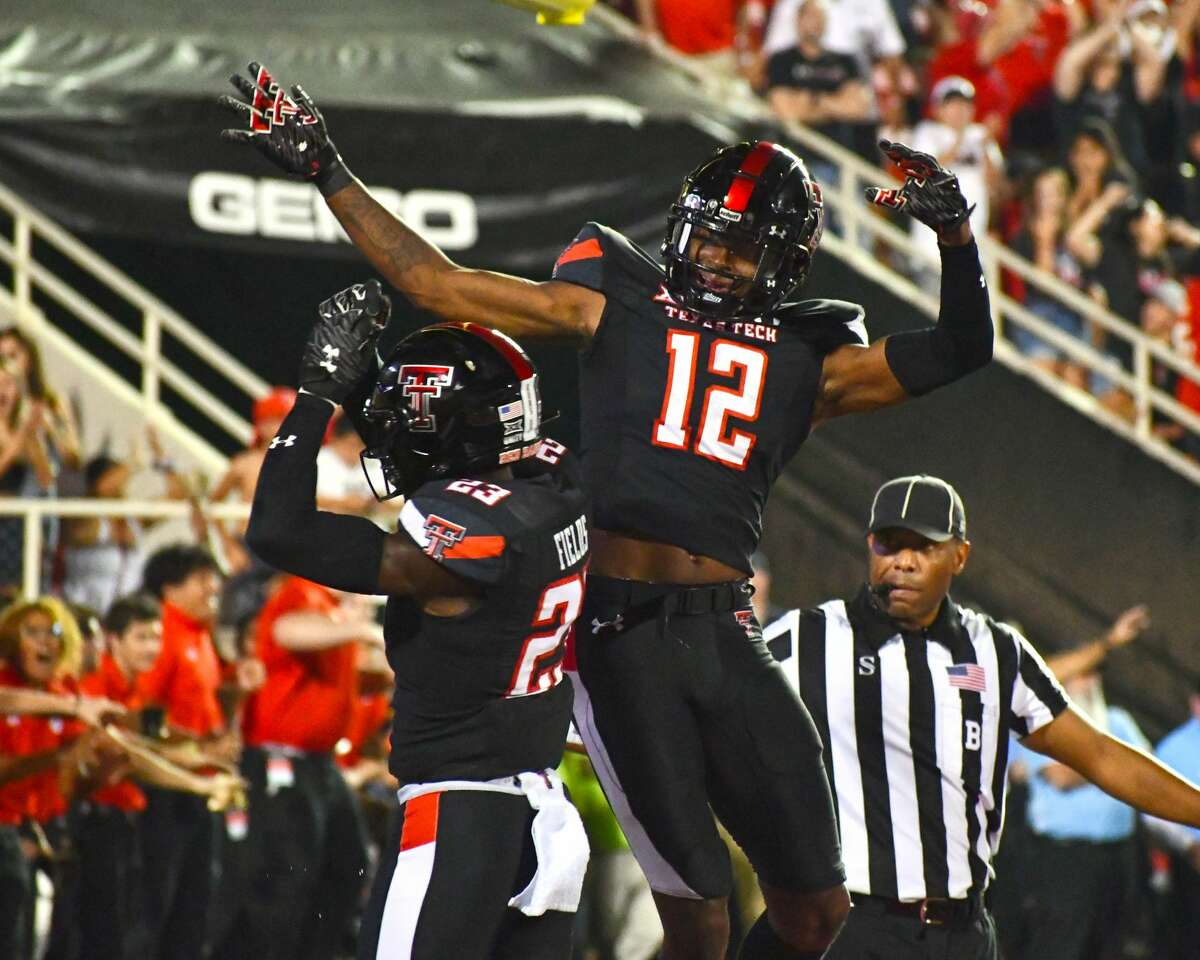 Red Raider defensive players Rayshad Williams (12) and DaMarcus Fields celebrate as SFA's 4th-and-goal pass attempt falls incomplete, preserving the victory.