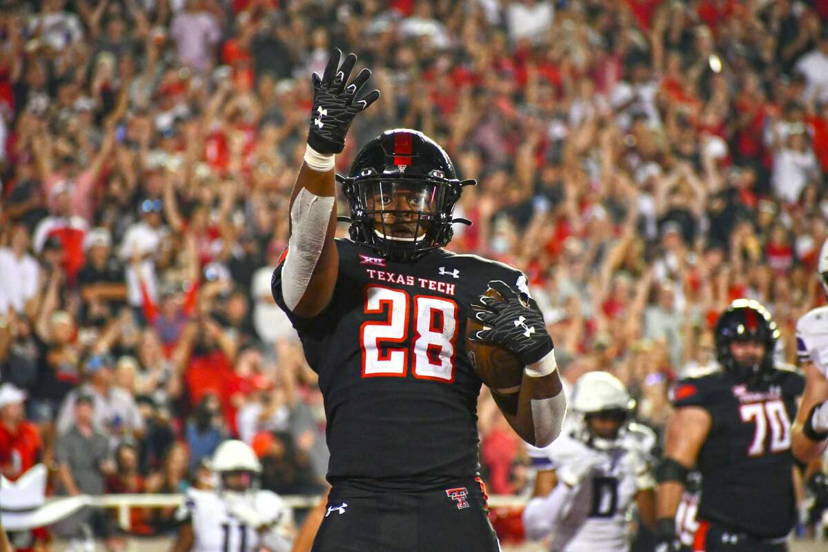 Texas Tech's Tahj Brooks blows a kiss to the crowd after his second touchdown run of the third quarter during the Red Raiders' 28-22 non-conference victory over Stephen F. Austin on Saturday in Jones AT&T Stadium at Lubbock.