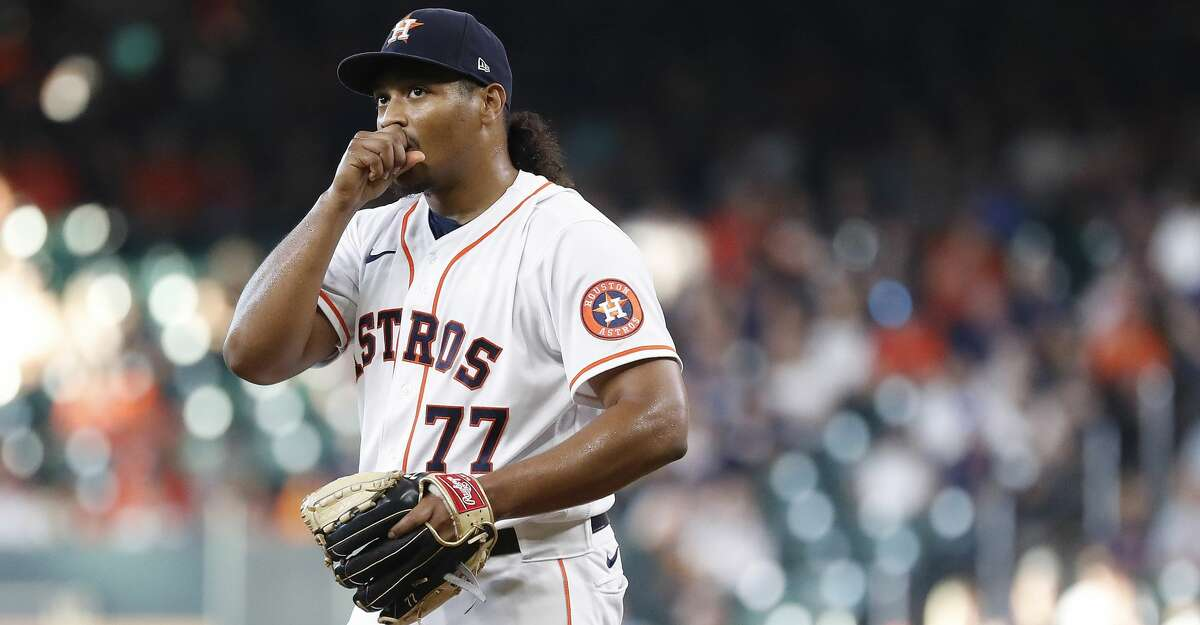 Houston Astros starting pitcher Luis Garcia (77) reacts after giving up a single to Los Angeles Angels Shohei Ohtani during the first inning a MLB baseball game at Minute Maid Park, Saturday, September 11, 2021, in Houston.