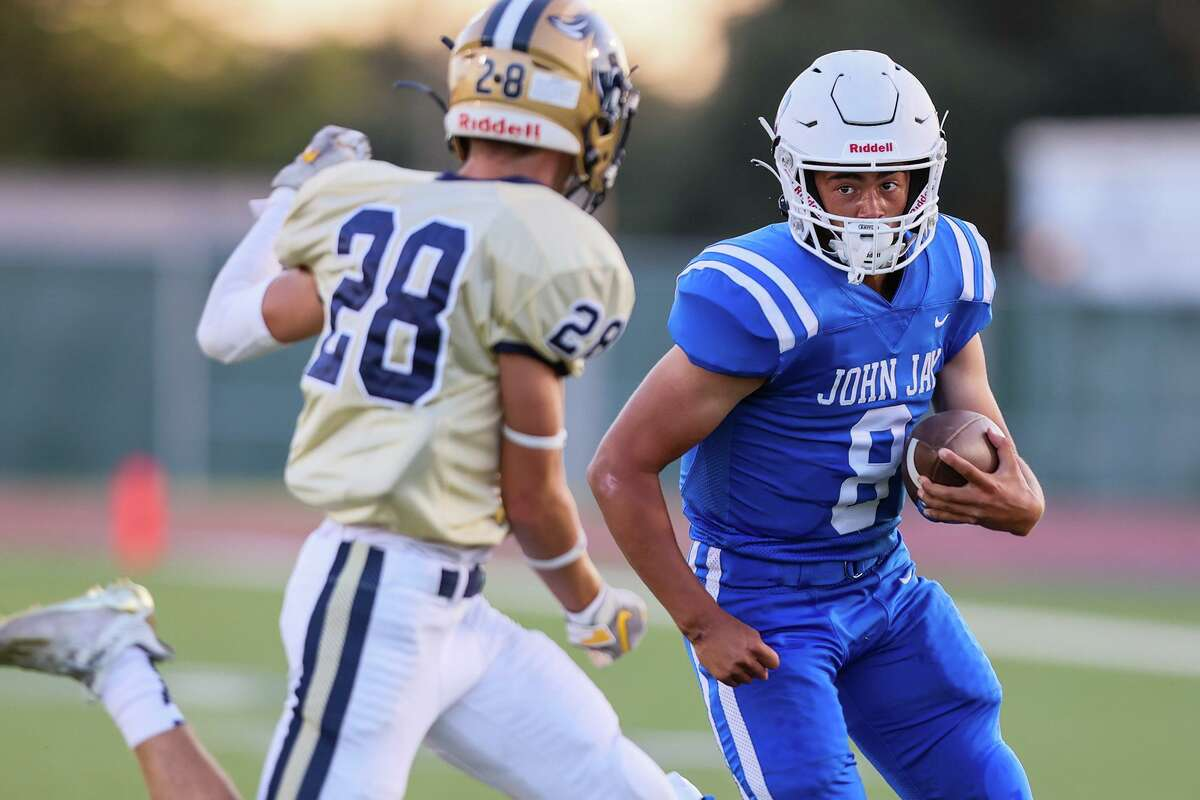John Jay quarterback Jackson Gutierrez, right, looks to get past O'Connor's Dylan Parisher during the first half of their District 29-6A high school football game at Gustafson Stadium on Saturday, Sept. 11, 2021. Jay beat O'Connor 35-25.