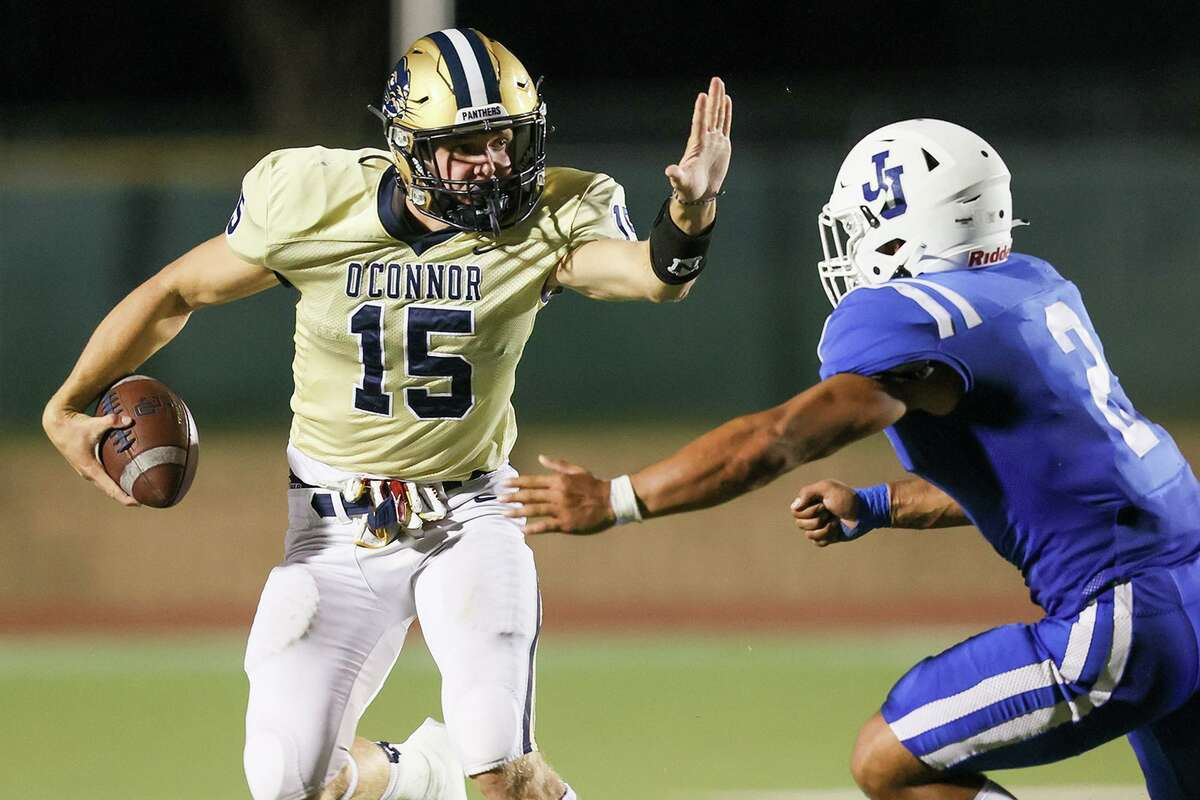 O'Connor's John Locke, left, tries to get past Jay's Xadrian Huerta during the second half of their District 29-6A high school football game at Gustafson Stadium on Saturday, Sept. 11, 2021. Jay beat O'Connor 35-25.