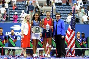 NEW YORK, NEW YORK - SEPTEMBER 11:  Leylah Annie Fernandez (2nd L) of Canada holds the runner-up trophy as Emma Raducanu(2nd R) of Great Britain celebrates with the championship trophy alongside Billie Jean King (R) and Stacey Allaster (L), USTA Chief Executive, after their Women's Singles final match on Day Thirteen of the 2021 US Open at the USTA Billie Jean King National Tennis Center on September 11, 2021 in the Flushing neighborhood of the Queens borough of New York City.