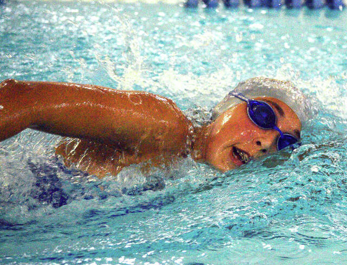 Edwardsville's Maddie Milburn won the 50-yard freestyle and helped the Tigers grab the championship of the Capital City Invitational Saturday at Springfield's Southeast's Eisenhower Pool.