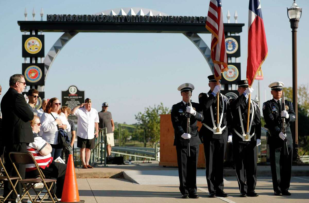 Members of the Conroe Fire Department's honor guard present the colors during a ceremony at the Montgomery County Veterans Memorial Park in honor of the 20th anniversary of the 9/11 terrorist attacks, Saturday, Sept. 11, 2021, in Conroe.