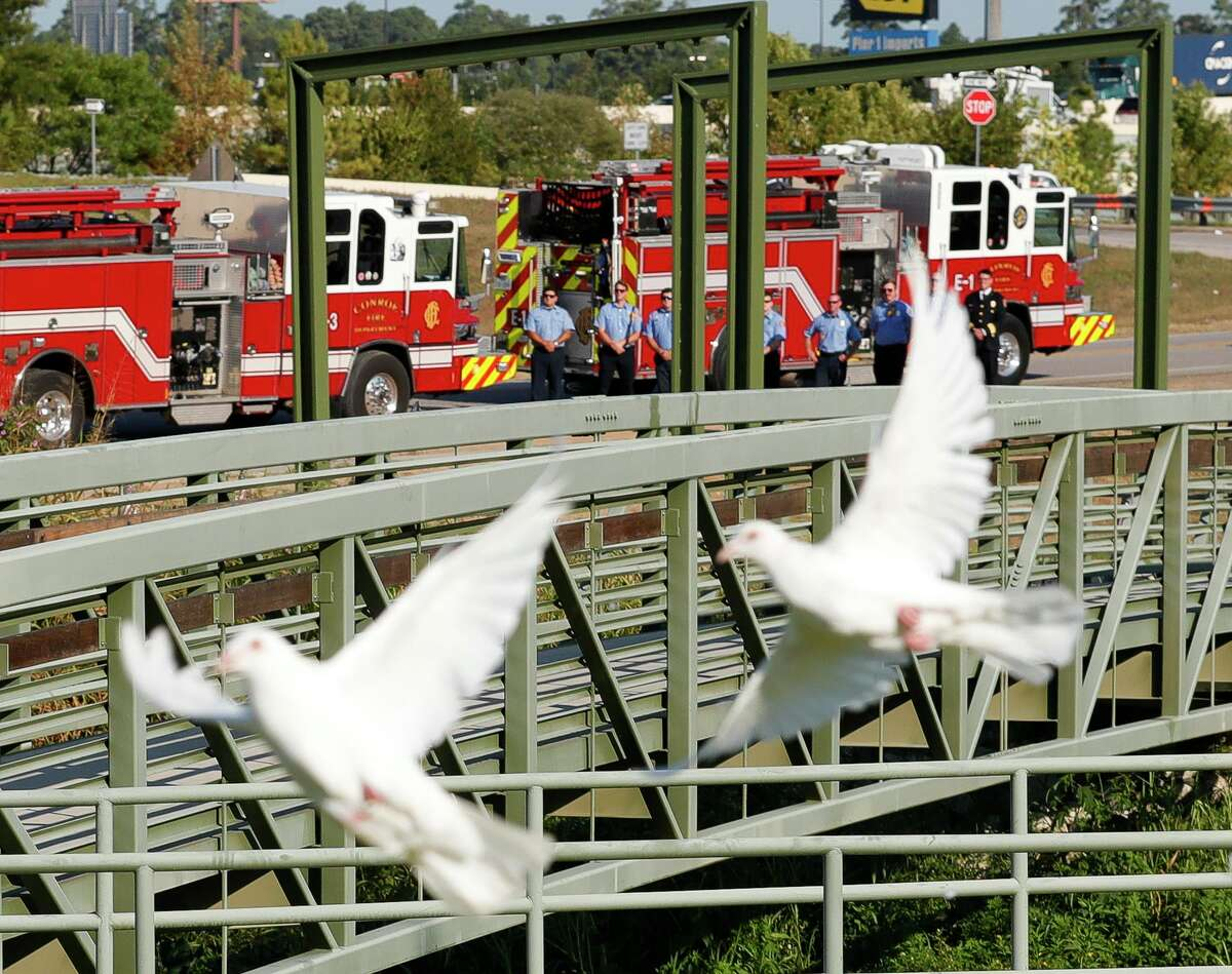 Conroe firefighters are seen as doves are released in remembrance of first responders during a ceremony at the Montgomery County Veterans Memorial Park in honor of the 20th anniversary of the 9/11 terrorist attacks, Saturday, Sept. 11, 2021, in Conroe.