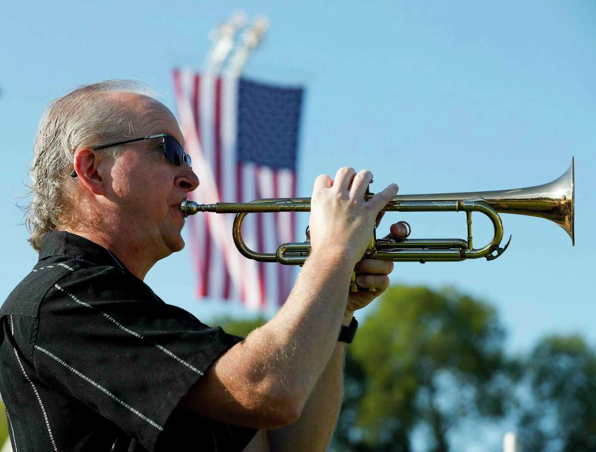 Stephen Kloesel plays Taps during a ceremony at the Montgomery County Veterans Memorial Park in honor of the 20th anniversary of the 9/11 terrorist attacks, Saturday, Sept. 11, 2021, in Conroe.