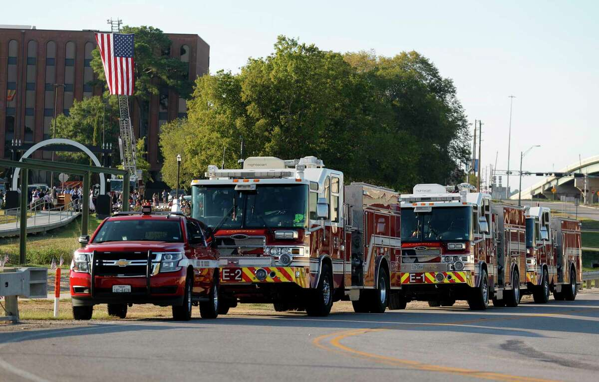 Conroe firetrucks are seen during a ceremony at the Montgomery County Veterans Memorial Park in honor of the 20th anniversary of the 9/11 terrorist attacks, Saturday, Sept. 11, 2021, in Conroe.