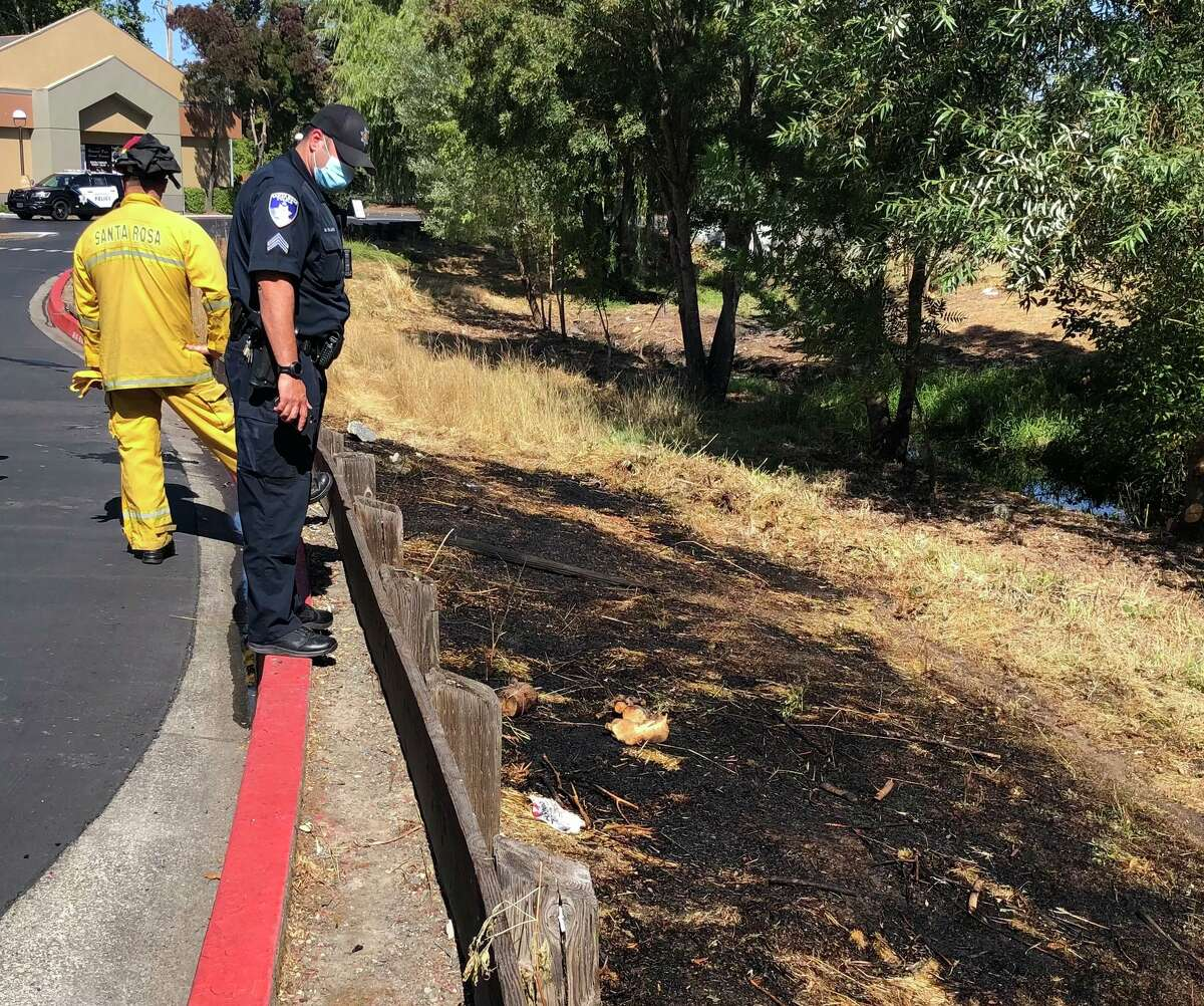 Fire personnel at the scene of a fire in the 3000 block of Marlow Road in Santa Rosa, Calif., on Sept. 11, 2021.