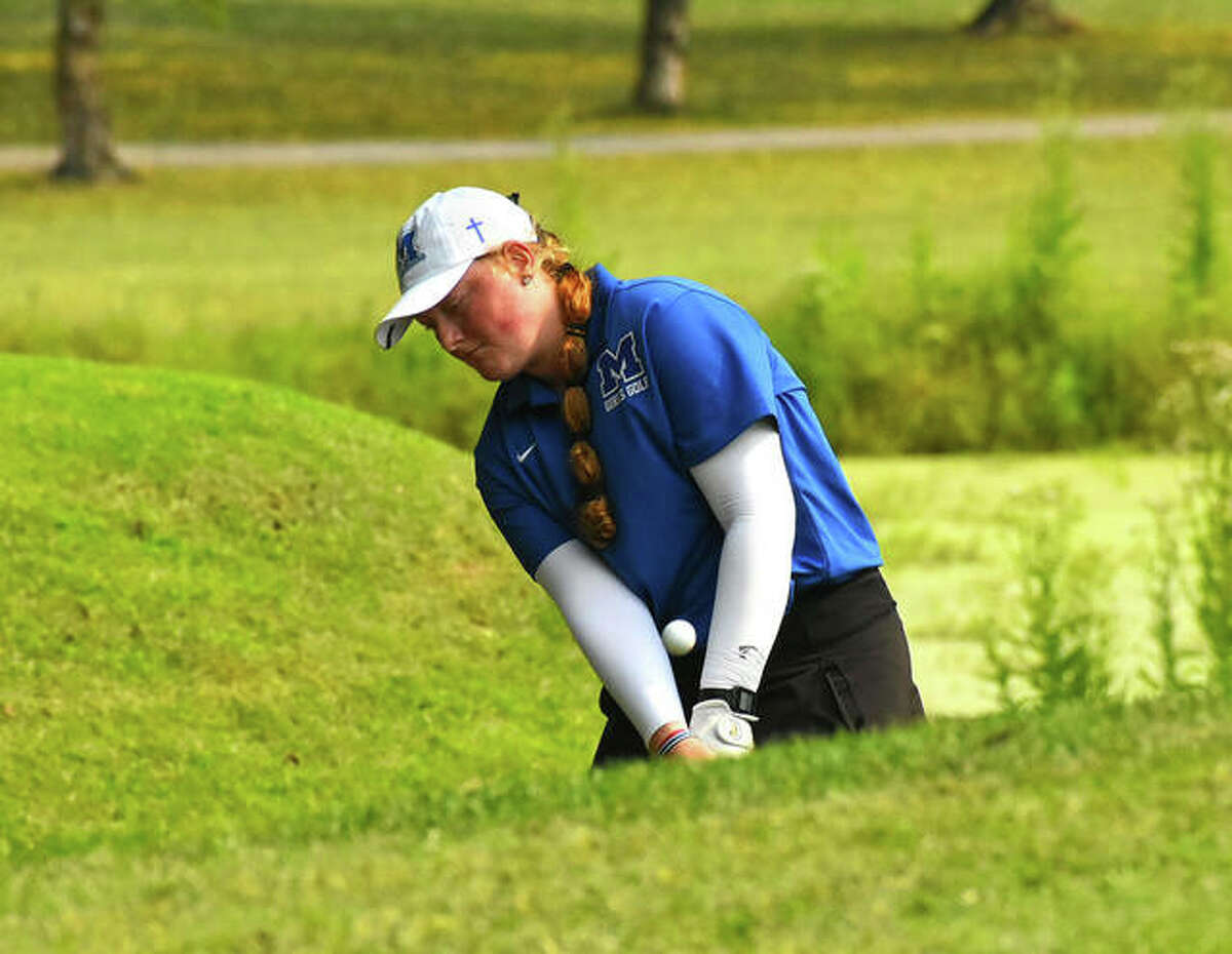 Marquette Catholic's Gracie Piar chips onto the green at hole No. 6 and hits the pin during her medalist round of 71 on Saturday at the Alton Classic girls golf tournament at Rolling Hills in Godfrey.