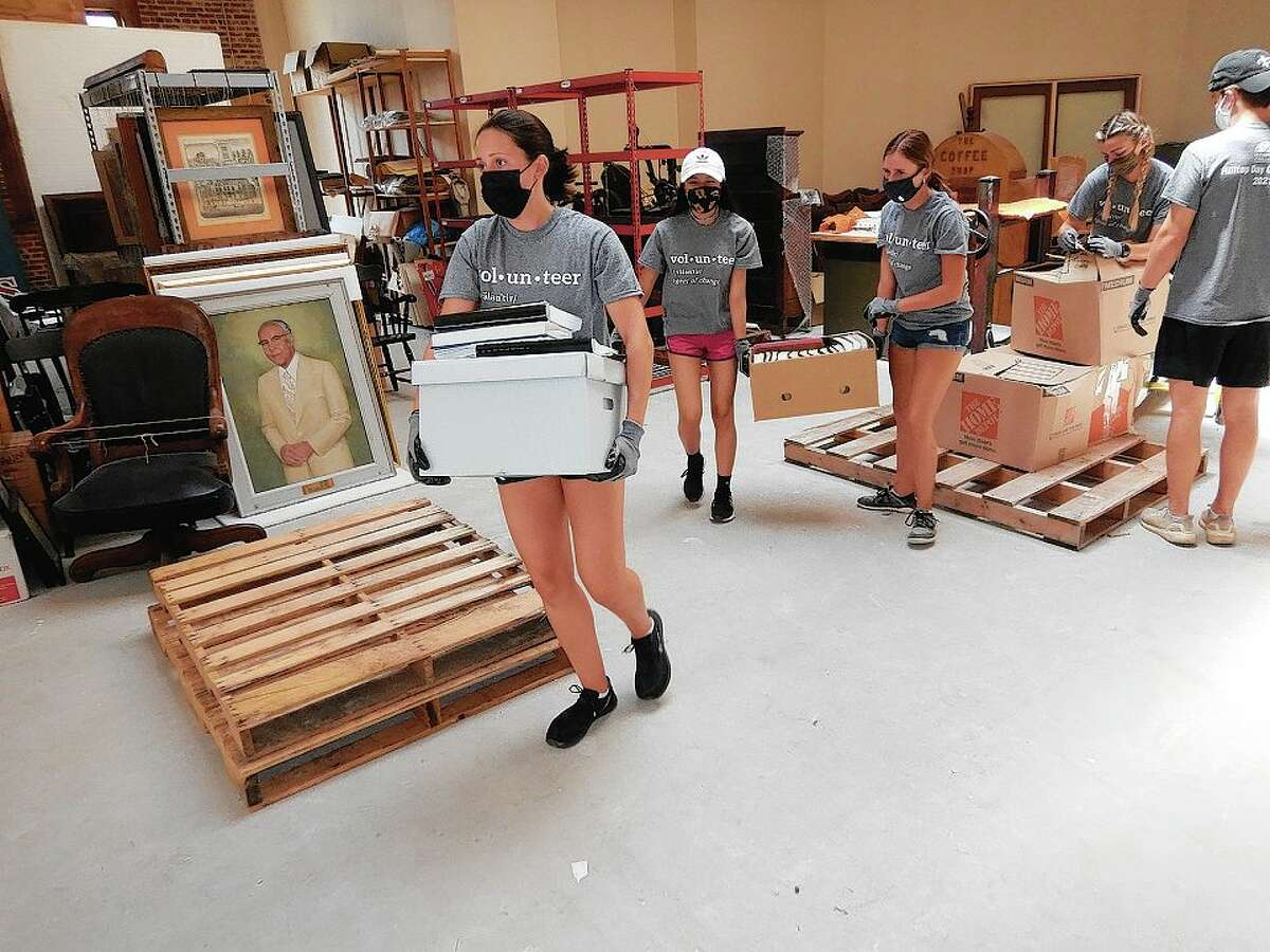 Montreal, Quebec, resident Katerina Maniatis and fellow Illinois College students carry boxes of artifacts at the Jacksonville Area Museum during the Day of Service.