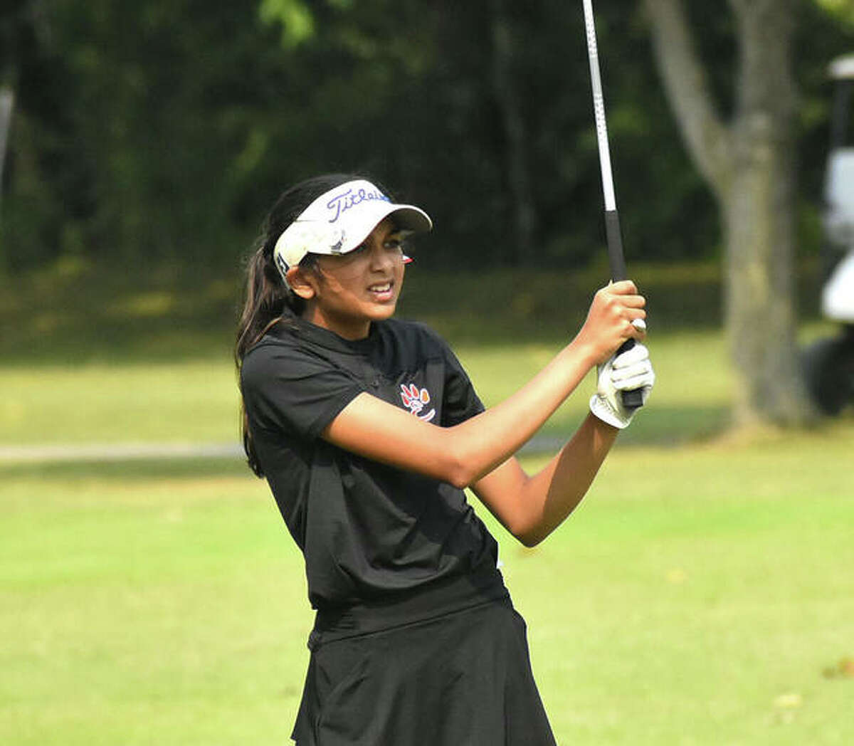 Edwardsville's Ruhee Gupchup reacts to her second shot on the third hole at Rolling Hills Golf Course during the Alton Invitational.