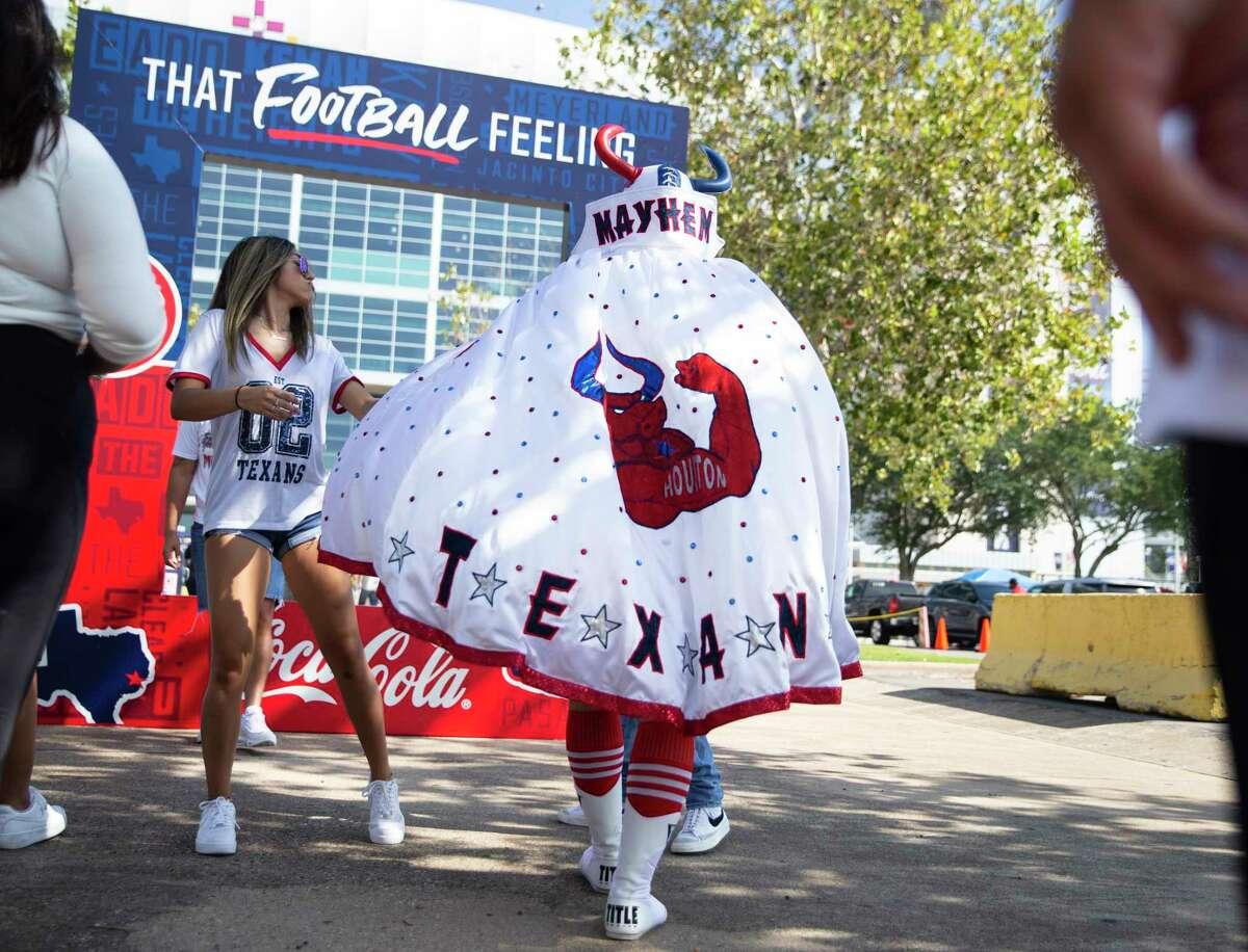 Houston Texans fan Mauro Celestino, known as Masked Mayhem, walks toward the stadium before the NFL game against Jacksonville Jaguars Sunday, Sept. 12, 2021, at NRG Stadium parking lot in Houston.