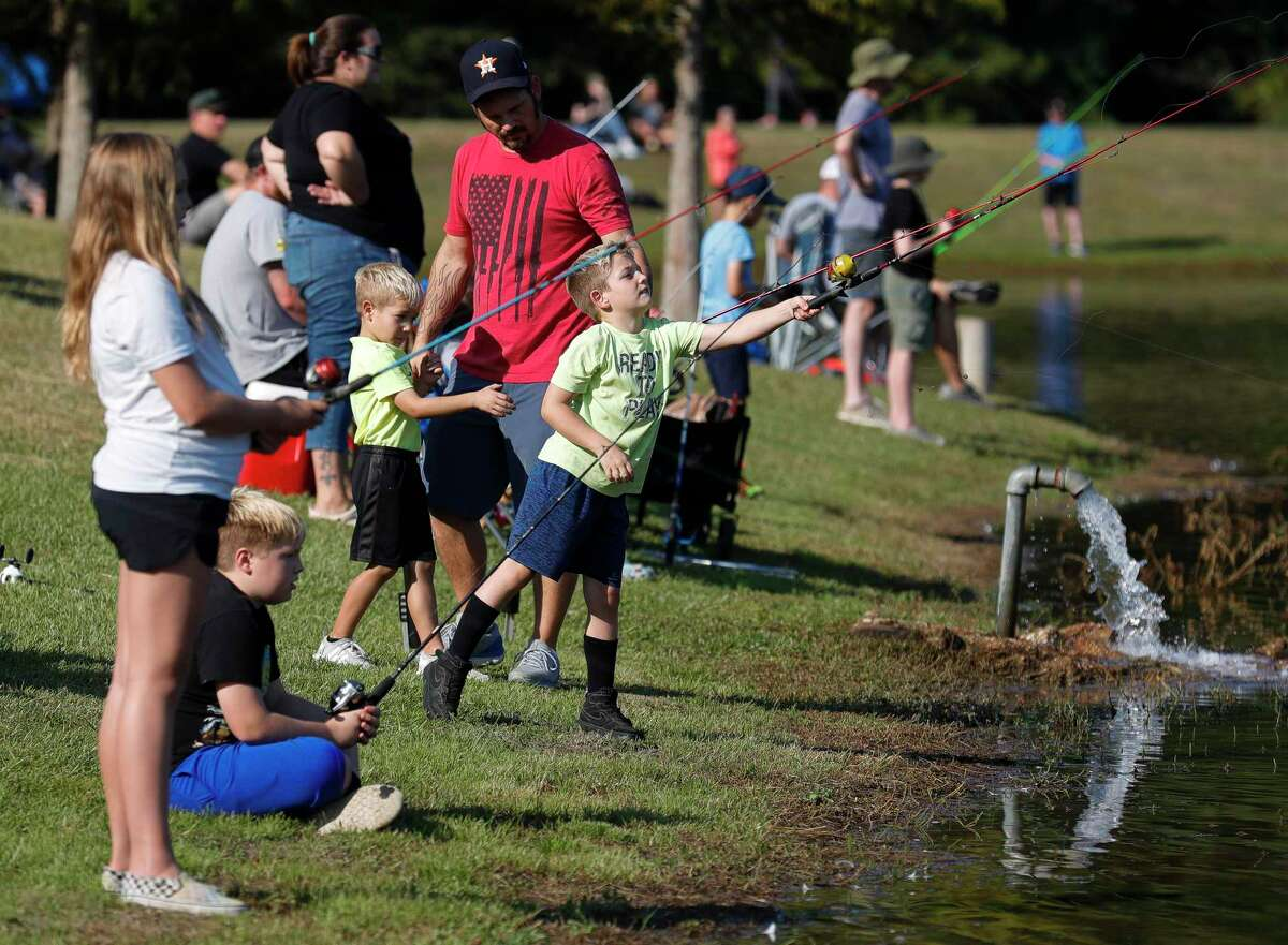 Jaxon Peruzzi casts his fishing line out during KidFish at Carl Barton, Jr. Park, Saturday, Sept. 11, 2021, in Conroe. The free event gave children 16 years old and young a chance to learn and gain appreciation for the sport of fishing as well as awareness for the environment.