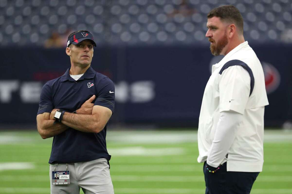 Houston Texans general manager Nick Caserio and offensive coordinator Tim Kelly watch warm ups before an NFL football game Sunday, Sept. 12, 2021, in Houston.