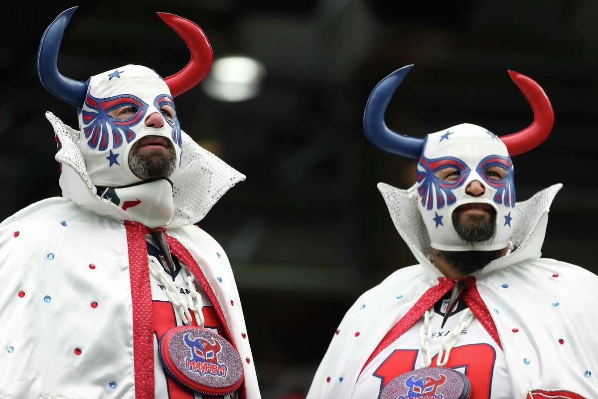 Houston Texans fans watch warm ups before an NFL football game Sunday, Sept. 12, 2021, in Houston.