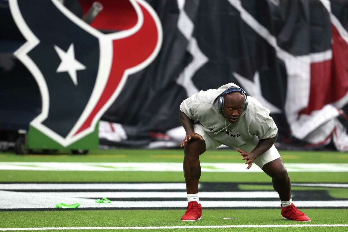 Houston Texans offensive tackle Laremy Tunsil warms up before an NFL football game Sunday, Sept. 12, 2021, in Houston.