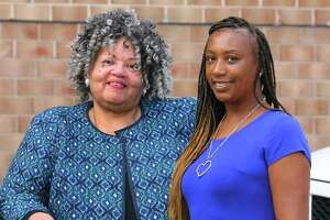 Bonnie Kim Campbell, left, and Melinda Punkin Baxter, right, Democrats running for the Board of Representatives in District 5, pose together at the Martin Luther King Jr. Apartments in Stamford, Conn., on Wednesday, Sept. 8, 2021.