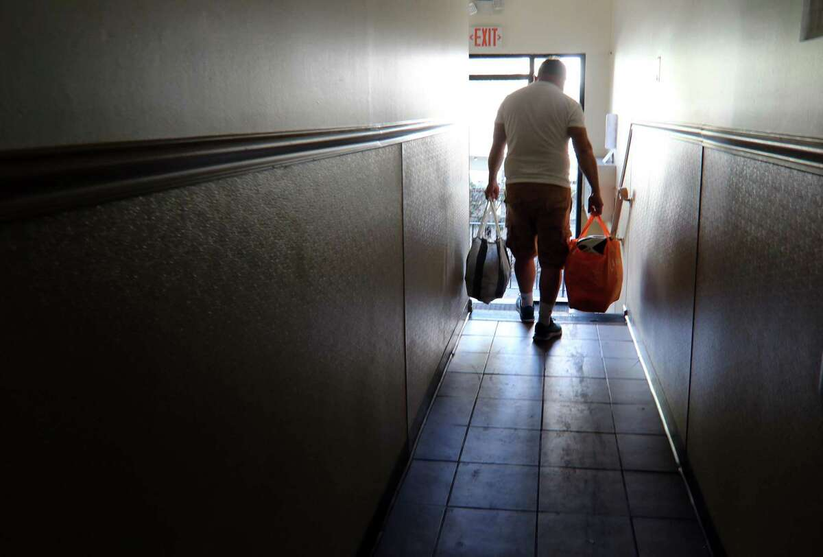 A resident moves his belongings from his unit at Cove Road Apartments in Stamford, Conn., on Tuesday Sentember 7, 2021. Remnants of Hurricae Ida last week caused damage to the apartments, forcing residents to find alternative housing.