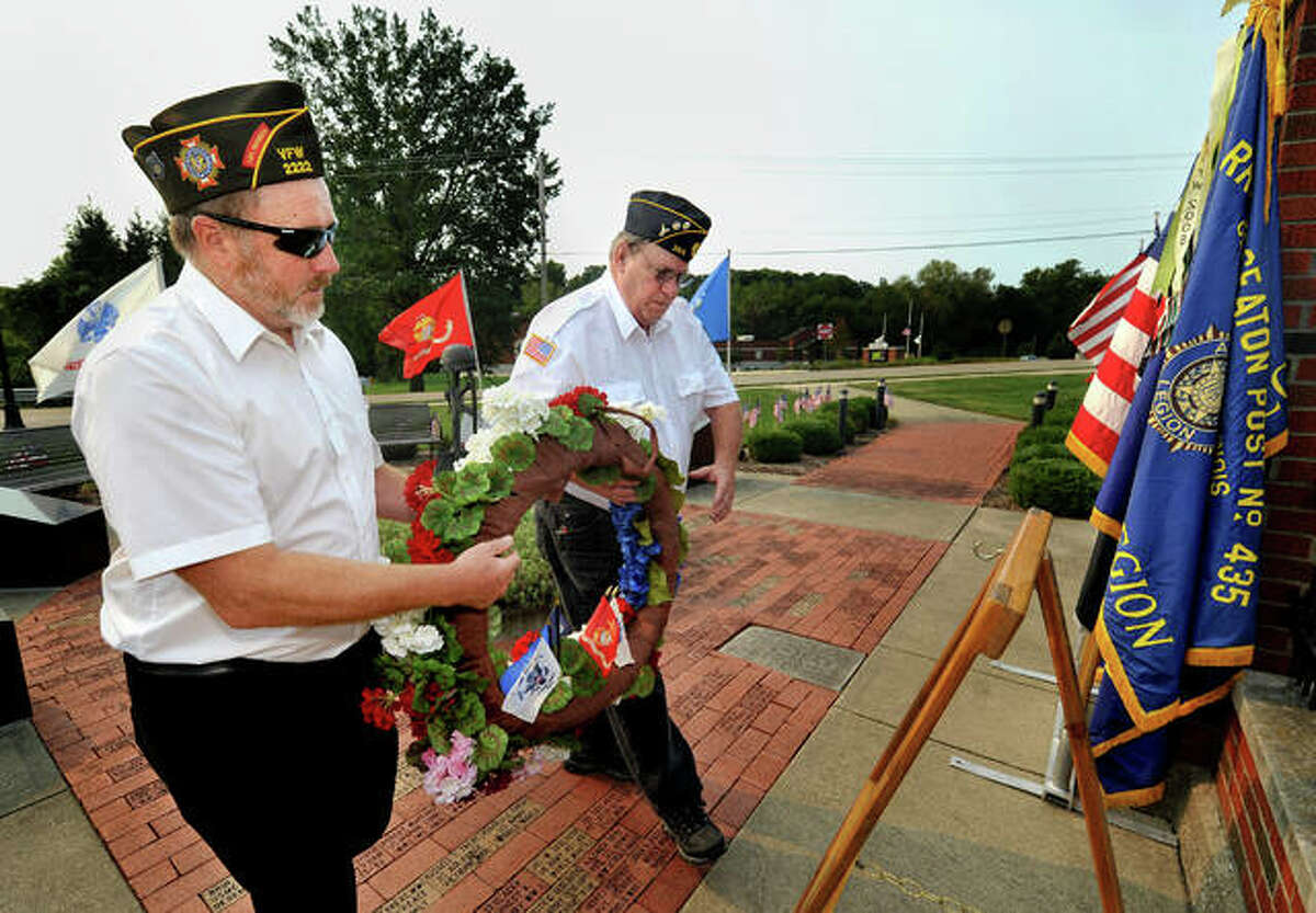 Joe Michalski of VFW Post 2222, left, and Joe Osborn of the American Legion Post 435 and VFW Post 2222, place a wreath during a September 11 ceremony at the Glen Carbon Veterans Memorial Saturday. The ceremony drew a relatively small crowd, which made for an intimate setting where community members took part in several acts to remember the thousands of people who died on Sept. 11, 2001, in terrorist attacks on the United States.
