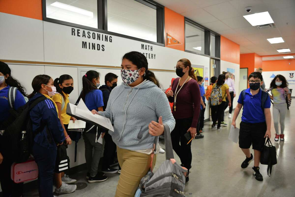 KIPP Aspire Academy students transition between classes. The charter network requires all students and teachers to wear masks.