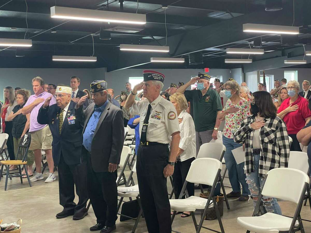Visitors to the Katy VFW 9/11 memorial service listen to the National Anthem on Saturday, Sept. 11.